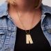 Gullbelagt smykke i rustfritt stål med 2 anheng